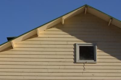Sealing and painting Masonite siding