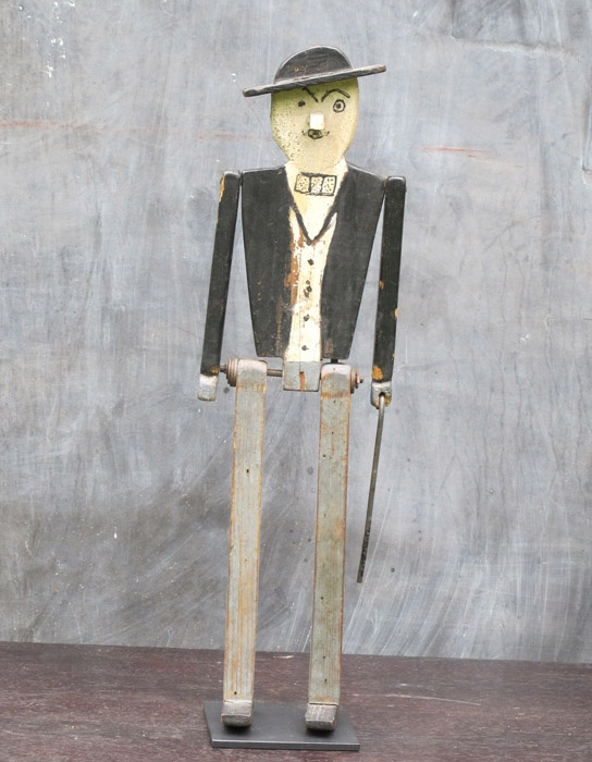 MAN WITH HAT AND CANE  The cane maybe short but this folky figure has lots of character. Original painted surface with a stick in back to make him walk or dance. Ex. Kahn collection