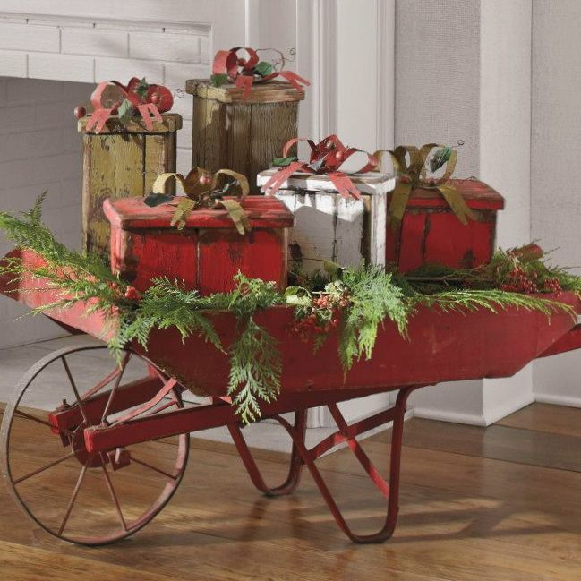 Old Red Wheelbarrow...stuffed full of pine & prim wrapped gifts.