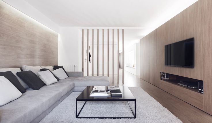 A Subtle Spanish Apartment Done in White and Wood Tones Spanish studio onside took on the refurbishment and interior design of the GM Apartment in the El Ensanche district of Valencia, Spain. Designed for a family of five, the project had to address their storage and circulation issues, as well as too many dark spaces with no natural ventilation. The result is a spacious, light-filled apartment decked out in pure white and warm wood tones.