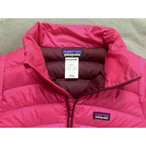 "Patagonia Girls Down Sweater Jacket Rossi Pink XL A practically new Girls' Patagonia Down Sweater Jacket in Rossi Pink. I have worn it 2 times and there are no rips, tears, stains, or problems with the zippers. It's a kids XL and I'm 5' 2"" and it fits with room for a big sweatshirt underneath. Patagonia Jackets & Coats Puffers"