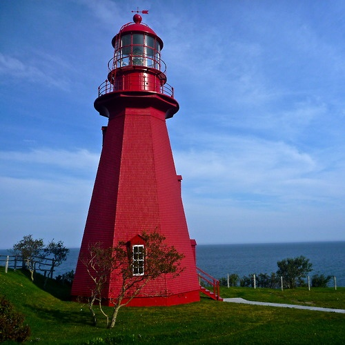 Red lighthouse on the north coast of the Gaspé Peninsular, Quebec.