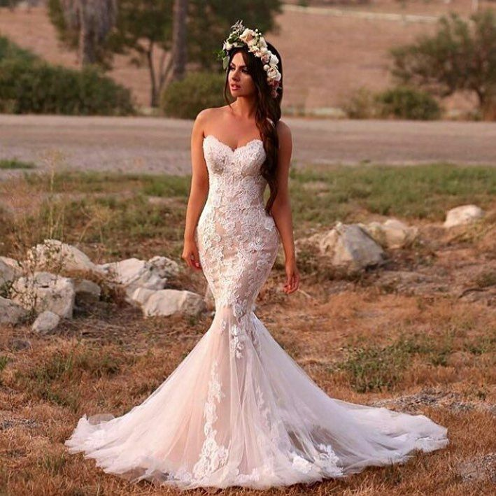 This soft lace wedding gown has a romantic feel.  The strapless mermaid cut is flattering.  We can make sweetheart bust #weddingdresses like this lace one for you with ease.  Custom designs & #replicas of couture #dresses is our specialty.  We can work from any images you have.  For more info on inspired designs and custom dresses please email us directly.  Thanks!  DariusCordell.com