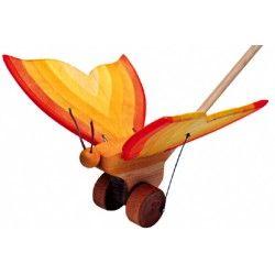 ♡Ostheimer Loopvlinder♡   Vrolijk gekleurde vlinder met fladderende vleugels. Achterop de vlinder zit een stok waarmee de vlinder vooruit kan worden geduwd. Afmeting 17 x 2 x 21 cm. ~Ostheimer~