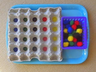 Colour Sorting - egg tray and pompoms