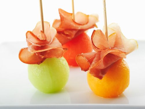 melon balls w/ prosciutto ribbons. This looks so much easier than mom's version of slices with it wrapped around.