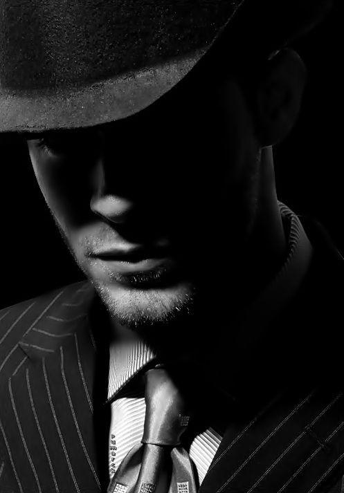 Cant see his eyes making him look mysterious and dangerous. this creates the film noir style by using the low-key lighting and hard lighting
