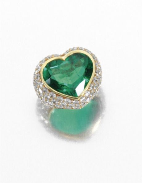 JEWELS FROM THE COLLECTION OF LILY MARINHO - Emerald and diamond ring -  Centring on a heart-shaped emerald, the yellow gold mount pavé-set with brilliant-cut diamonds. YES YES YES AND UH HUH!!