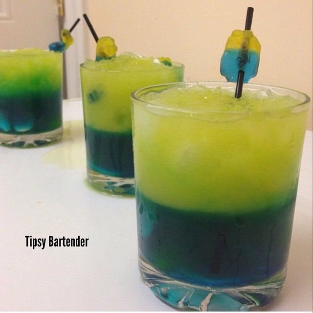 TIPSY MINIONS  Bottom Layer: Blue Curacao 6 oz Ginger Beer 1 oz Triple Sec Pour into rocks glass with crushed ice  Top Layer: 1 or 2 oz Honey Whiskey 6 oz Orange Juice Garnish with Minion Jelly Sweets, serves 3.