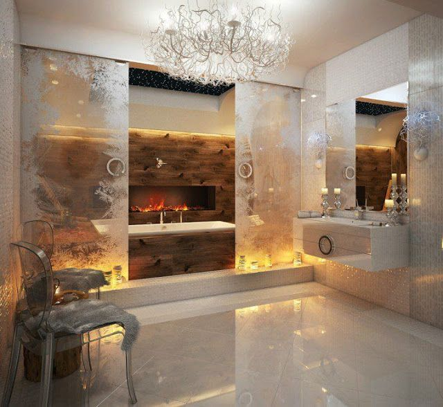 Amazing marbled bath with glass doors that reveal fireplace & tub.