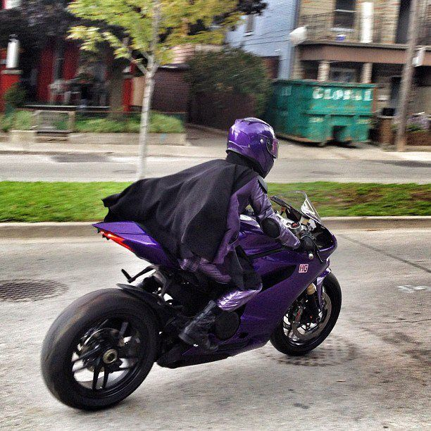Hit-Girl from the Kickass movie.  Cute Chloe Moretz on a crotchrocket.  If I had a daughter I'd want her to be Hit-Girl.