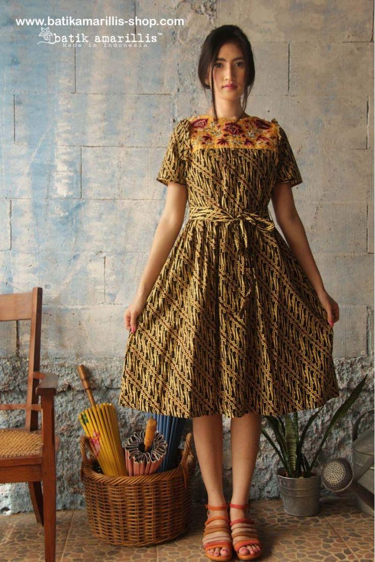 www.batikamarillis-shop.com Batik Amarillis's Innocencia dress ......with ruffled at chest, softly pleated skirt, it is truly a sweetheart dress.. Made of sogan parang batik kawung Banyumas & Tasikmalaya krancang embroidery -Indonesia