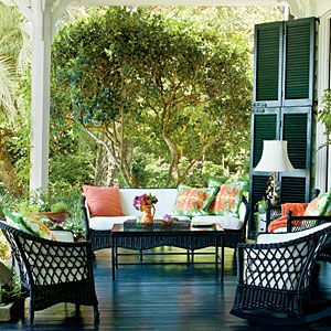 """In Charleston, the porch is almost more important than interior rooms. I designed mine with company in mind."" —Muffie Faith Photo: Laurey W. Glenn. Southern Living (May 2013). [Something really nice about wooden floors outside."