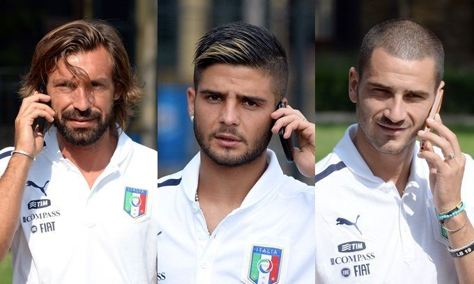 cool Italian soccer players on their cellphones