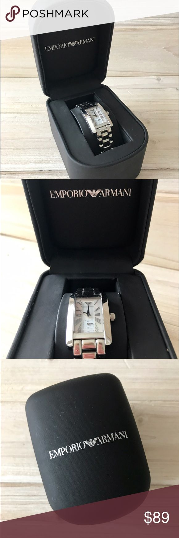 Emporio Armani Ladies Silver Classic Watch Emporio Armani Ladies Silver Classic Watch. Sophisticated style featuring a rectangular face, mother of pearl dial, Roman numeral numbering, and stainless steel throughout. Minute markers around the inner ring. Dial Type: Analog. Quartz movement. Scratch resistant mineral crystal. Pull / push crown. Good condition with some scratches on the back of watch and bezel. Will need a battery ($5). Includes extra link and original case which has remnants of…