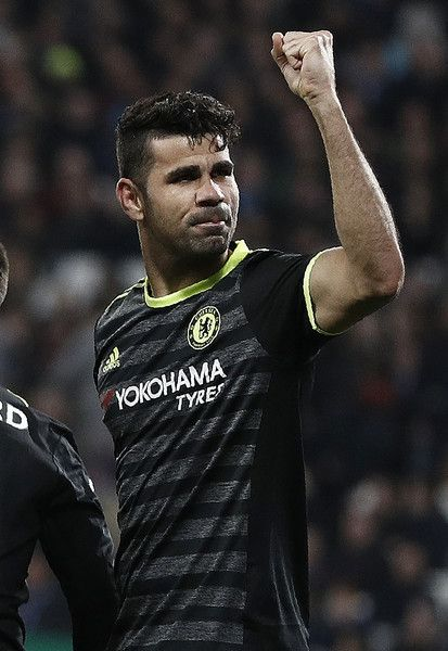 Chelsea's Brazilian-born Spanish striker Diego Costa celebrates scoring his team's second goal during the English Premier League football match between West Ham United and Cheslsea at The London Stadium in east London on March 6, 2017. / AFP PHOTO / Adrian DENNIS / RESTRICTED TO EDITORIAL USE. No use with unauthorized audio, video, data, fixture lists, club/league logos or 'live' services. Online in-match use limited to 75 images, no video emulation. No use in betting, games or single…