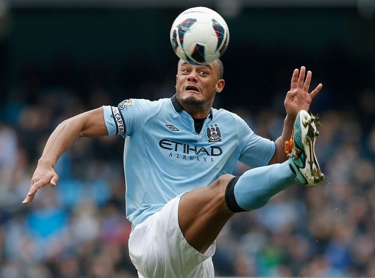 Manchester City's Vincent Kompany stretches for the ball during their English Premier League soccer match against Newcastle United at The Etihad Stadium in Manchester, northern England, March 30, 2013. REUTERS/Phil Noble