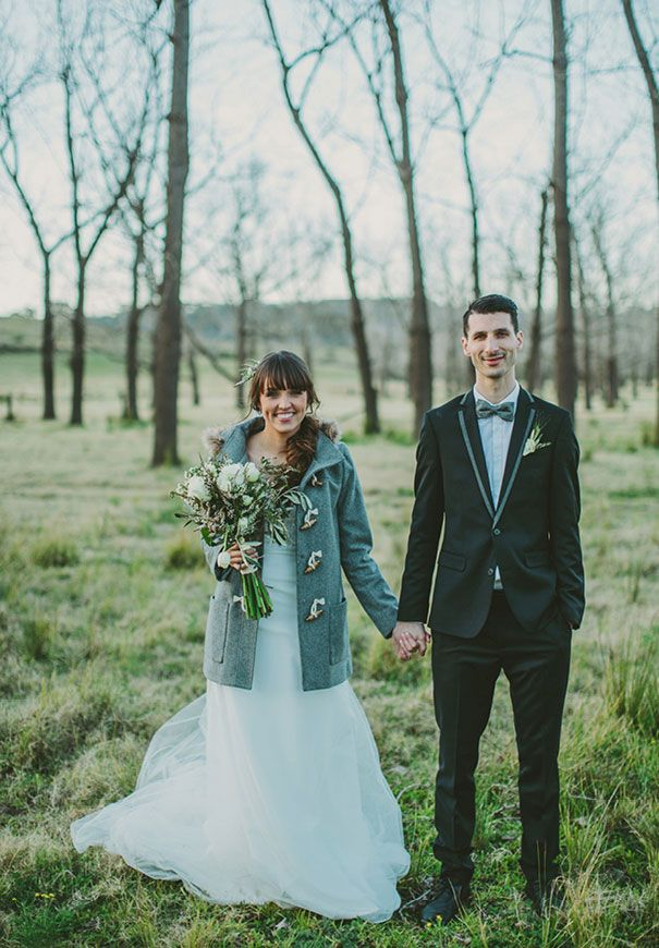 Pretty winter wedding -- love the bride's teal coat, and it matches the groom's bowtie!