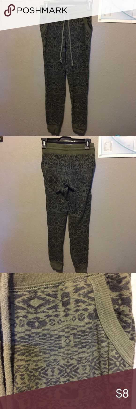 """Green joggers w/ Aztec print Super cute green joggers with a black Aztec print all over. Two real pockets on the front and a draw string waist. In seam is about 29"""" and the waist is about 26"""", but has stretch in it. Great used condition, unfortunately too small for me now! Merona Pants Track Pants & Joggers"""