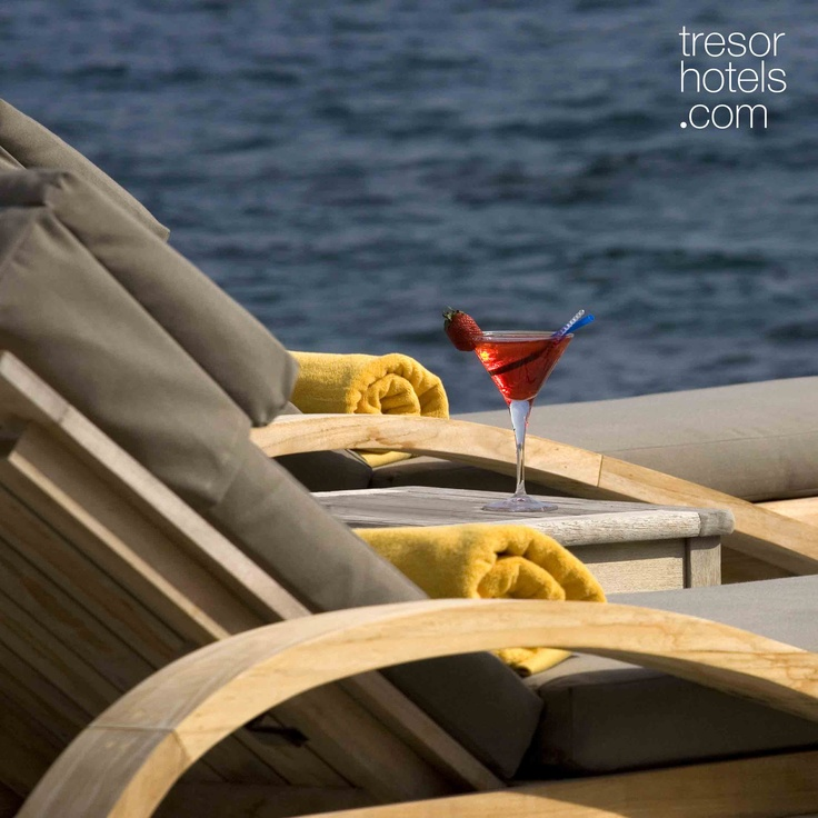 Trésor Hotels and Resorts_Luxury Boutique Hotels_ It is outdoors that the deep blue of the Aegean Sea plays eternally with the rock of Cavo Grosso. The owner's stories about the glorious past of the small port that lies before you, will make you think that soon enough a boat with large white sails will turn in and you will be the sole lucky spectator. You will sense that you are part of a place where time has no restrictions or dimensions. It just stops...and allows you to enjoy it at ease.