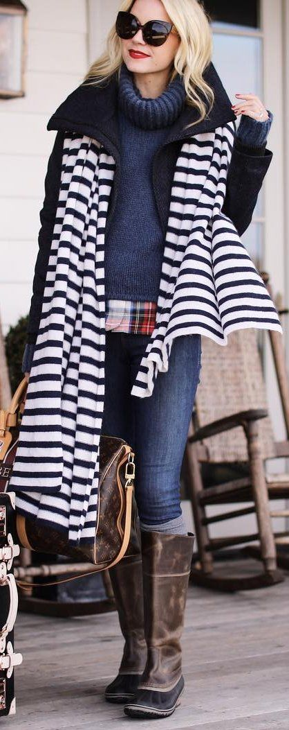 Striped Scarf + Black Coat + Navy Turtleneck + Skinny Jeans + Brown Leather Boots