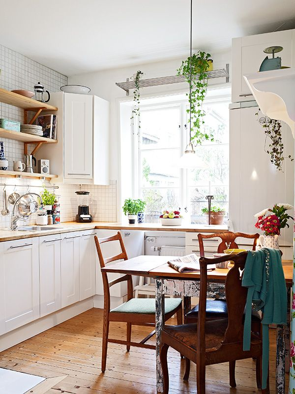 petite ikea kitchen - note the open plant shelf above the window (nice!)