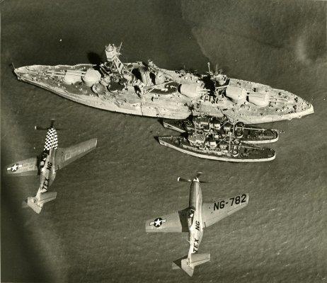 USS Texas Battleship BB-35 with Texas National Guard P-51 over head.