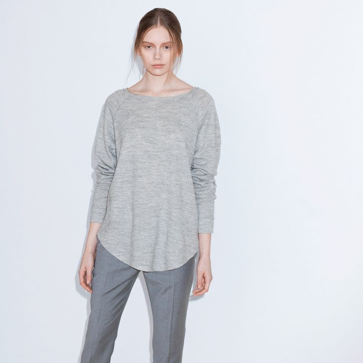 June is a fine-knitted college wool sweater with raw egde details and raglan sleeves.