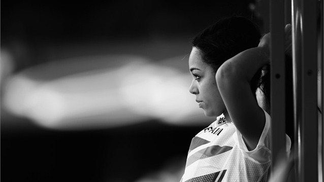 This image has been converted to black and white. Katarina Johnson-Thompson of Great Britain looks on during the Women's Heptathlon High Jump on Day 7 of the London 2012 Olympic Games at Olympic Stadium