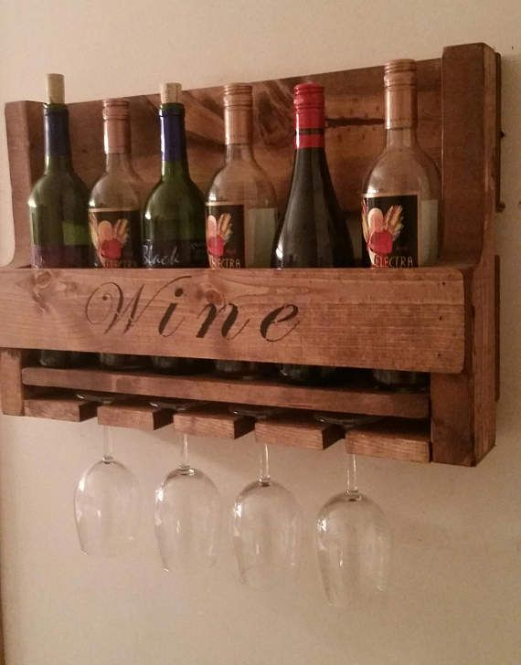 Rustic Pallet Wine Rack. This Wine Rack is Approx 14 1/2 tall x 22 wide x 5 deep. It will hold 6 Standard size bottles of Wine and has space for 4 Wine Glasses in the holder mounted in the bottom of the rack. The first photo is with a Chestnut Stain. Please select your choice of finish