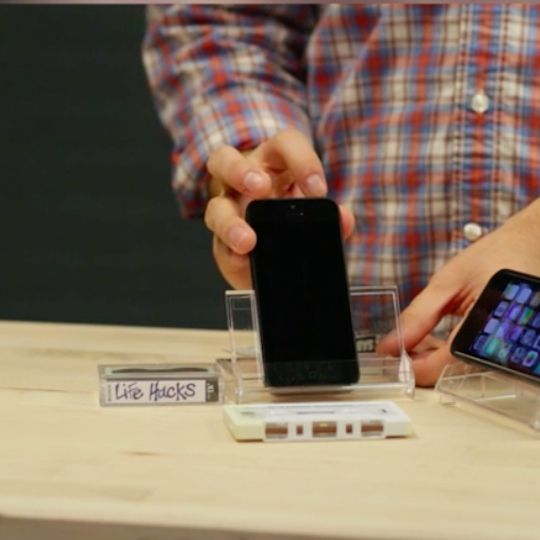 Turn an old cassette tape case Into an iPhone stand. Mix a little old school functionality with new technology.
