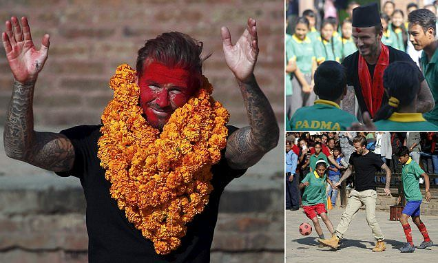 David Beckham has his face painted crimson after Nepal charity game