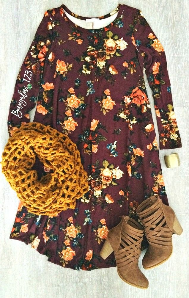 Gorgeous Floral Dress in Burgundy featuring a vintage floral motif throughout. Ultra-soft material with a longer length and fit and flare style. Two side seam pockets. Note the longer length on this d