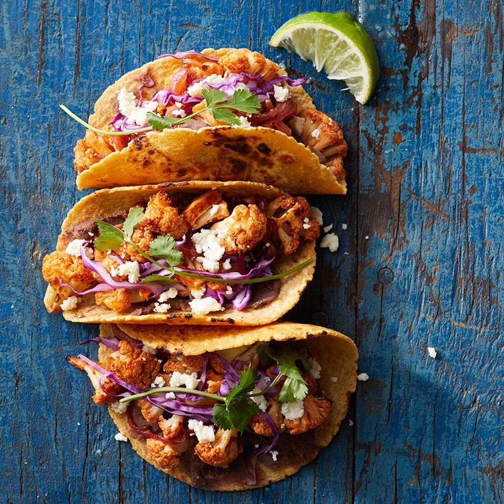 In this vegetarian taco recipe, cauliflower is tossed with a smoky-tangy sauce made with honey, lime juice and chipotles in adobo sauce before being roasted. Serve with more hot sauce, if desired.
