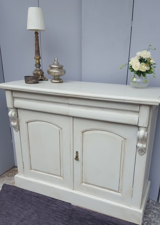 lovely simple sideboard painting in a warm white chalk paint then sealed with an antique wax