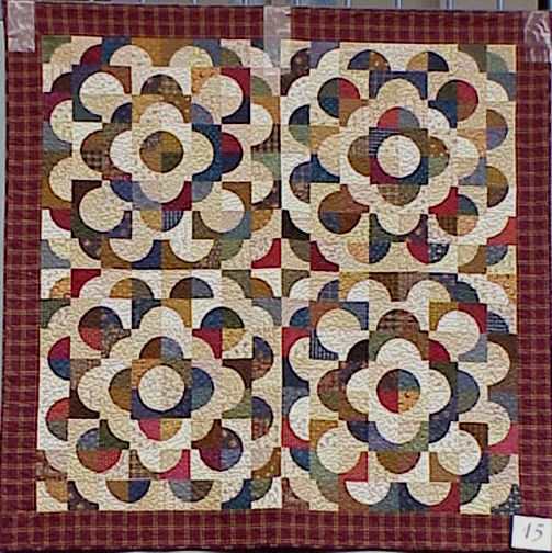 Drunkard's Path Variation, 2000, machine pieced and appliqued by Lori Gillick and quilted at the Quilted Sandwich by Annemarie Yohnk.                                                                                                                                                                                 More