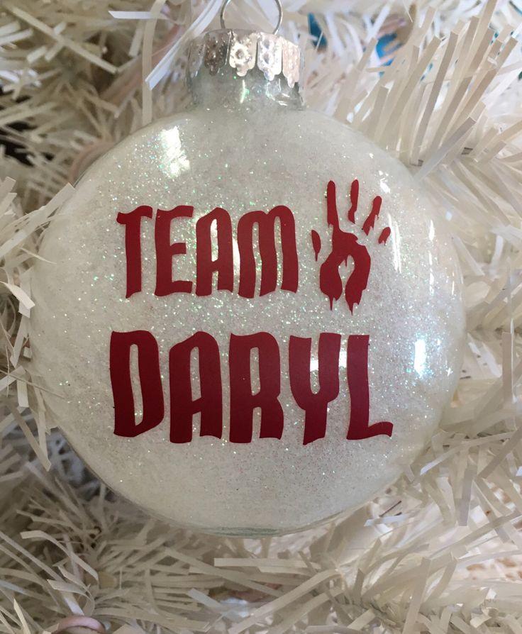 A personal favorite from my Etsy shop https://www.etsy.com/listing/482796367/walking-dead-team-daryl-ornament-walking