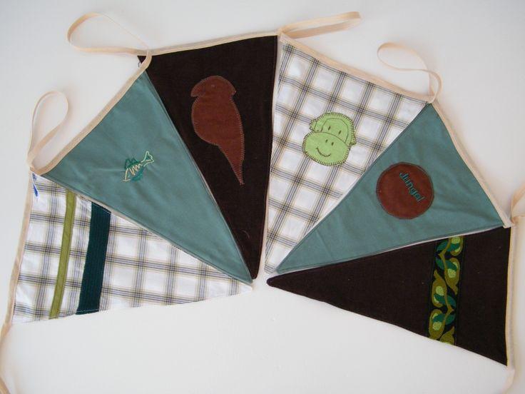Stoere vlaggenlijn, voor een vrolijke versiering voor de kinderkamer of voor een verjaardag. Met papagaai, vis, aap, jungle