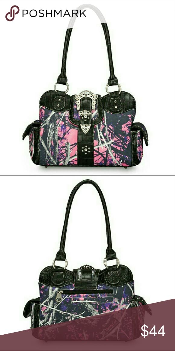 """NEWMUDDY GIRL MOONSHINE CAMO PURSE A new Muddy Girl camo Moonshine Camo Rhinestone purse. It has a rhinestone buckle accent closure. Inside side pockets, 2 side pockets on the outside and 10""""double handle drop. Muddy girl  Bags Satchels"""