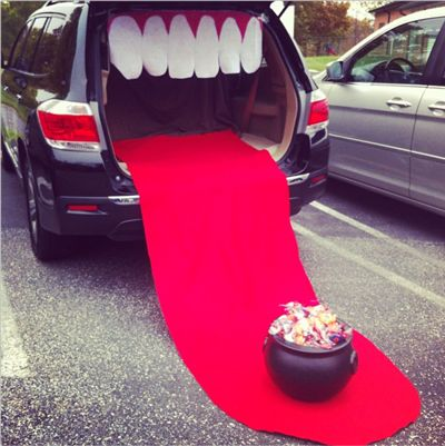 Trunk-or-Treat Ideas -- Such a clever and easy idea to turn your trunk into a giant mouth. I love how they put the candy bucket at the end of the tongue!