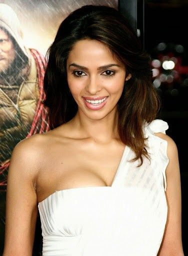 Hot Glamorous look Mallika Sherawat in New brown colorful shorts tops
