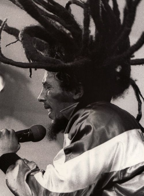 "Someone who internationally introduced the movement of the Rastafarian culture is reggae artist Bob Marley. For example, the song ""One Love/People Get Ready"" expresses the Rastafari credo, ""One God, One Aim, One Destiny"" which Marcus Garvey strived to follow. The song asks to help others through peace and harmony, something Mr. Marley expressed through most of his songs."