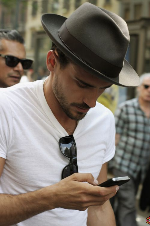 My style: plain white tee, hat, sunglasses and smart phone