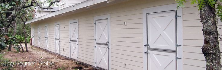 Exterior Dutch doors are shown above and painted white to match barn fascia.