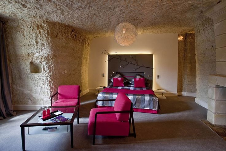 One of the chambers in Les Hautes Roches (The High Rocks) hotel in Rochecorbon, France - photo from leshautesroches;  This room is in a hotel built inside a cave, beside the Loire River.  The cave was created when rock was quarried there to build nearby chateaus.
