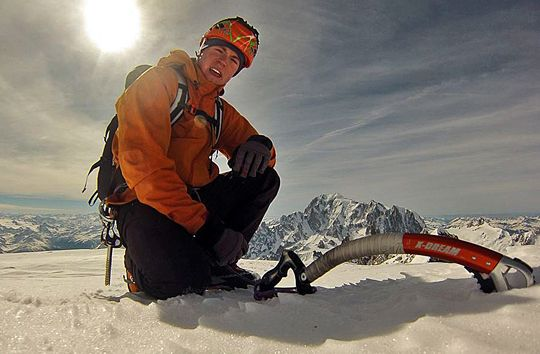 Tom Ballard pauses for a summit photograph on the summit of the Grandes Jorasses after speeding up the Colton-MacIntyre. Photo by Tom Ballard. From Alpinist Magazine @alpinistmag