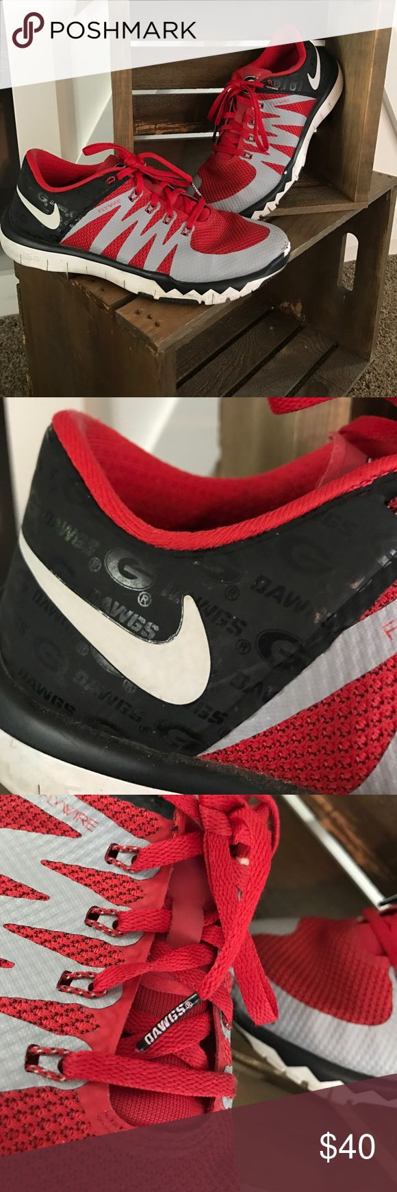 Nike Flywire 5.0 UGA shoes.Size 6.5 boys 7.5 women UGA Nike shoes. I let me step son wear to school 1 day.... I freaking day and he scuffed them etc. before he wore them I wore than maybe 5-6 times.😖 pics show the marks where he ruined them. Other than the cosmetic stuff you n pics they are like new on bottoms and inside. Nike Shoes Sneakers