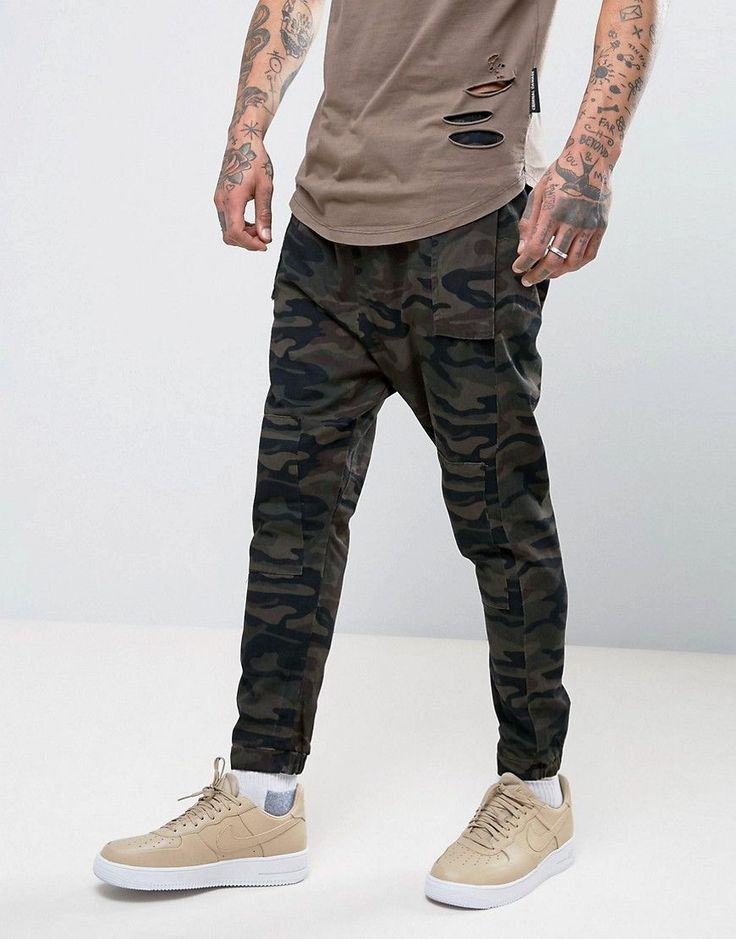 Get this Asos's joggers now! Click for more details. Worldwide shipping. ASOS Drop Crotch Joggers In Camo Twill Overdye - Green: Joggers by ASOS, Cotton twill, Drawstring waistband, Side slant pockets, Two back pockets, Dropped crotch, Skinny fit - cut closely to the body, Machine wash, 100% Cotton, Our model wears a 32/81cm Regular and is 192cm/6'3.5 tall. ASOS menswear shuts down the new season with the latest trends and the coolest products, designed in London and sold across the world…