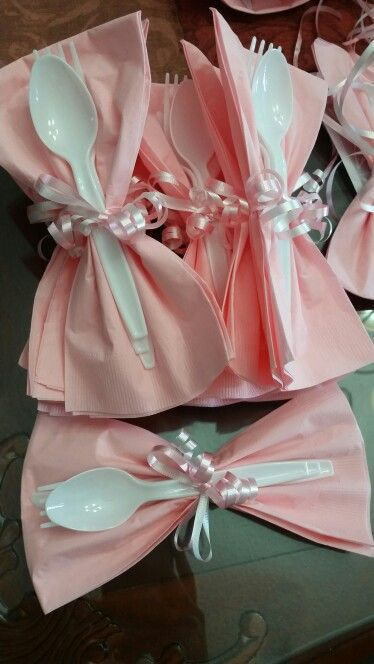 Baby shower, pink and wite, cute utensils bow with ribbons.