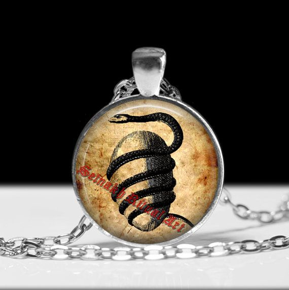 Amazing handcrafted orphic egg and serpent snake pendant.  The high quality picture is covered by a durable high gloss glass bubble which both